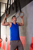 Rings workout man at gym hanging — Stock Photo