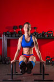 Parallettes woman parallel bars workout at gym — Stock Photo