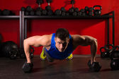 Push-up strength man hex dumbbells workout at gym — Stock Photo