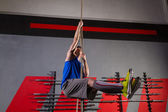Rope Climb exercise man workout at gym — Stock Photo