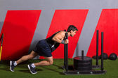 Sled push man pushing weights workout exercise — Foto de Stock