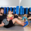 Abdominal plate training core group at gym — Stock Photo #47220059