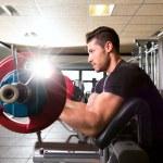 Biceps preacher bench arm curl workout man at gym — Stock Photo #47220377