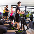 Aerobics elliptical walker trainer group at gym — Stock Photo #47226997