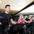 Aerobics elliptical walker trainer group at gym — Stock Photo #47227089
