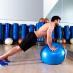 Fitball abdominal push ups Swiss ball man — Stock Photo #47227265