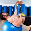 Dumbbell chest press on fit ball man workout — Stock Photo #47227671