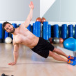Fitness side push ups man pushup at gym — Stock Photo