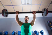 Barbell man workout fitness at weightlifting gym — Stock Photo