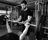 Bench press weightlifting man with personal trainer — Stock Photo