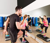 Cardio step dance group at fitness gym training — Stock Photo