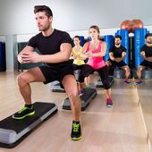 Cardio step dance squat group at fitness gym — Stock Photo