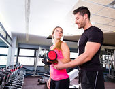 Gym personal trainer man with dumbbell woman — Stock Photo