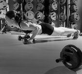 Push-ups woman with dumbbells workout fitness — Stock Photo