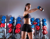Dumbbell woman workout fitness at gym — Stock Photo