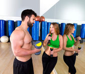 Dumbbell personal trainer man and woman talking — Stock Photo