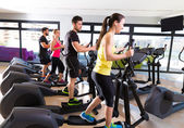 Aerobics elliptical walker trainer group at gym — Stock Photo