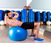 Fitball abdominal crunch Swiss ball man at gym — Stock Photo