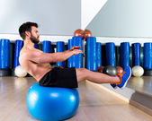 Fitball abdominal balance crunch Swiss ball man — Stock Photo