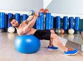 Dumbbell bench press on fit ball man workout at  gym — Stock Photo