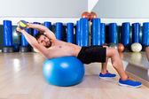 Dumbbell bench press on fit ball man gym workout — Stock Photo
