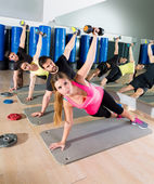 Dumbbell push up group functional training at gym — Stock Photo