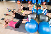 Fitball crunch training group core fitness at gym — Stock Photo