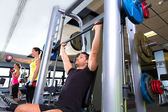 Fitness gym man multipower system weightlifting — Stock Photo