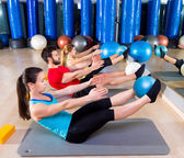 Pilates softball the teaser group exercise at gym — Stock Photo
