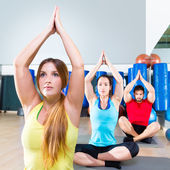 Yoga training exercise in fitness gym people group — Stock Photo