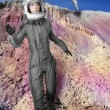 Astronaut fashion stand woman space suit helmet — Stock Photo #5495327