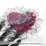Hand holding a broken glass heart — Stock Photo #5504032