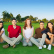 Friends group happy sitting green grass — Stock Photo #5511621