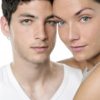 Beautiful young couple closeup portrait over white — Stock Photo #5512179