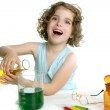 Beautiful chemistry little girl playing in lab — Stock Photo #5513183