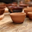 Clay crafts pottery studio wood table traditional — Stock Photo #5569737