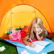 Children girl writing notebook in camping tent with flowers — Stock Photo #6214387