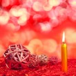 Christmas candles with dried baubles on red — Stock Photo #7003507