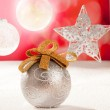 Christmas silver bauble and star on snow red — Stock Photo #7470699