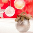 Christmas silver bauble and star on snow red — Stock Photo #7470723