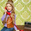 Kid girl retro talking busybody in red telephone — Stock Photo #8806900