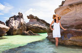 Young girl on a background of sea reefs — Stock Photo