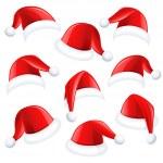 Santa hats — Stock Vector