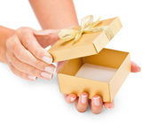 Hands holding an opened gift box — Stock Photo