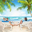 Loving couple relaxing on the beach — Stock Photo