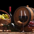 Still life with wine bottles, glasses and oak barrels — Stock Photo #48641061