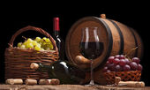 Still life with wine bottles, glasses and oak barrels — Stock Photo