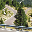 Hairpin bends in the Italian Alps at Passo Sella - Stock Photo