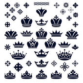 Set of crowns and decorative elements — Vector de stock