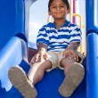 Portrait of a cute little indian boy at playground — Stock Photo #12738618